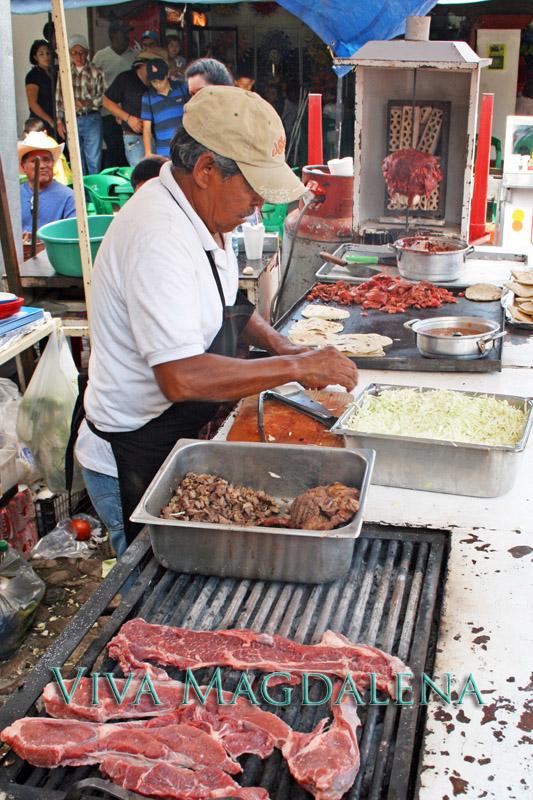 preparing carne asada at the fiestas de octubre in magdalena de kino sonora